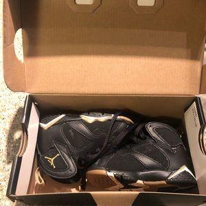 Kids Jordan 7 retro 5c toddler size 5 black gold